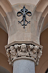 Decorative column of the Cloth Hall in the Main Market Square of Krakow, Poland. The columns of the Cloth Hall in Krakow are decorated with the faces for important historical figures