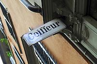 Coiffeur sign on hair salon in Switzerland