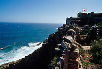 The castle-style beach house is perched on the edge of Robberg cliff overlooking Plettenberg Bay