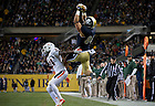 Oct. 6, 2012; Tight end Tyler Eifert makes a catch as Miami defensive back defends during the second quarter of the Shamrock Series at Soldier Field in Chicago. Photo by Barbara Johnston/University of Notre Dame..