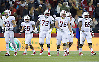 SEATTLE, WA - September 28, 2013: From left, Stanford players wide receiver Devon Cajuste, running back Tyler Gaffney, offensive tackle Cameron Fleming, guard Kevin Danser, quarterback Kevin Hogan and center Khalil Wilkes walk to the line of scrimmage during play against Washington State at CenturyLink Field. Stanford won 55-17.