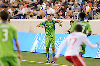 Leonardo Gonzalez (19) of the Seattle Sounders on a throw in. The Seattle Sounders defeated the New York Red Bulls 1-0 during a Major League Soccer (MLS) match at Red Bull Arena in Harrison, NJ, on May 15, 2010.