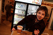 Dylan Wilson, 5, enjoys a cup of hot chocolate on a cold Friday night at Johnny's, 901 West Main Street, Carrboro, March 11, 2011.