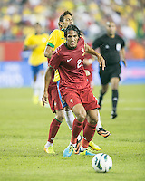 Portugal defender Bruno Alves (2) dribbles past Brazil forward Neymar (10).  In an International friendly match Brazil defeated Portugal, 3-1, at Gillette Stadium on Sep 10, 2013.
