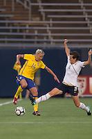 Sweden midfielder Josefine Oqvist (14) avoids tackle by US forward Megan Rapinoe (11). The US Women's national team beat Sweden, 3-0, at Rentschler Field on July 17, 2010.