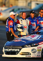 Feb 12, 2016; Pomona, CA, USA; NHRA pro stock driver Allen Johnson (center) with crew chief and father Roy Johnson (left) during qualifying for the Winternationals at Auto Club Raceway at Pomona. Mandatory Credit: Mark J. Rebilas-USA TODAY Sports