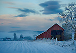 Washington, Eastern, Stevens County, Chewelah. A barn at dawn in the Chewlah Valley in winter.