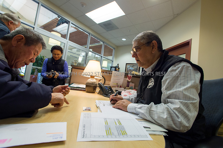 2/14/2013--Bellevue, WA, USA..Khawja Shamsuddin volunteers at the Factoria Police Station inside the Factoria Mall. The office also offers help for low income residents, many immigrants seeking help with city services such as water bills...An urbane retired banker from Bangladesh, Shamsuddin also volunteers tirelessly at both the Crossroads Mini City Hall and the mosque. Debadutta Dash, the Bellevue Westin's group sales manager and an exuberant master networker, labors to build ties between the linguistically fragmented local Indian communities, and between them and the homeland...©2013 Stuart Isett. All rights reserved.
