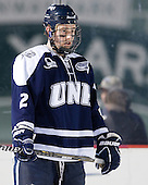 Connor Hardowa (UNH - 2) - The University of Maine Black Bears defeated the University of New Hampshire Wildcats 5-4 in overtime on Saturday, January 7, 2012, at Fenway Park in Boston, Massachusetts.