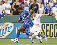 Logan Pause #8 of the USA is grabbed by Carlos Costly #13 of Honduras during a CONCACAF Gold Cup match at RFK Stadium on July 8 2009 in Washington D.C.USA won 2-0.