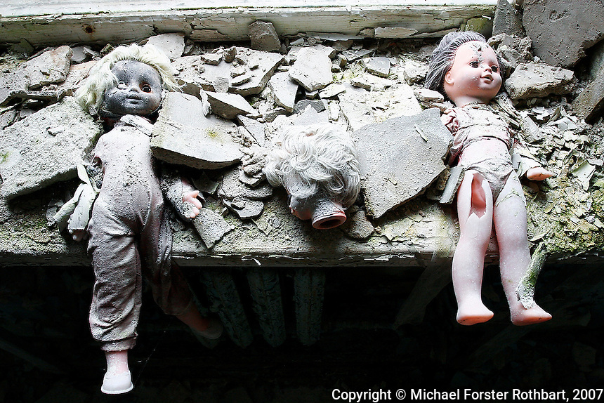 &quot;I only went back once. I couldn't stop crying.&quot;<br /> -- Galina  Dondukova, former Pripyat kindergarten director<br /> <br /> Pripyat, Ukraine, was a closed Soviet city, population 49,360, built to house workers at the Chernobyl plant one mile away. In the days following the accident, families were evacuated and told they could return in 3 days. Some have never returned, yet still mourn their paradise lost. Valuables were stolen long ago, but abandoned dolls remain on a windowsill in the Solntsye kindergarten.  <br /> ------------------- <br /> This photograph is part of Michael Forster Rothbart's After Chernobyl documentary photography project.<br /> &copy; Michael Forster Rothbart 2007-2010.<br /> www.afterchernobyl.com<br /> www.mfrphoto.com <br /> 607-267-4893 o 607-432-5984<br /> 5 Draper St, Oneonta, NY 13820<br /> 86 Three Mile Pond Rd, Vassalboro, ME 04989<br /> info@mfrphoto.com<br /> Photo by: Michael Forster Rothbart<br /> Date:  4/2007    File#:  Canon 20D digital camera frame 4996 <br /> ------------------- <br /> Original caption: .Photo title:.Kindergarten in Pripyat..Caption:.Pripyat, a closed Soviet city with population 49,360, was built to house workers at the Chernobyl Nuclear Power Plant one mile away. Today Pripyat is an eerie ghost town. Any valuables have long-since been stolen, but abandoned dolls remain on a windowsill here in the Solntsye kindergarten...These dolls and other abandoned toys and clothing have remained scattered here for 24 years, since the town was evacuated shortly after the April 26, 1986 Chernobyl accident. In the days following the accident, families were evacuated and told they could return in 3 days. Some have never returned, yet still mourn their paradise lost. ..Quote: . &quot;I only went back once. I couldn't stop crying.&quot;.-- Galina  Dondukova, former Pripyat kindergarten director.-------------------