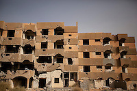 November 12, 2014 - Tawergha City, Libya: A block of flats is seen partially destroyed in Tawergha City ghost town after heavy clashes occured during 2011 war in Libya when Tawerghans were forced to move from their city home as they were harassed by the armed militias of Misrata during the uprising against Colonel Gaddafi. (Photo/Narciso Contreras)