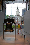 Liberty Bell and Independence Hall, observed by couple, mod rel..Philadelphia, Pennsylvania, PA USA.  Photo copyright Lee Foster, 510-549-2202, lee@fostertravel.com, www.fostertravel.com. Photo 266-30792