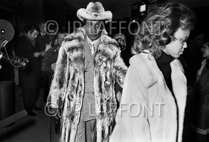 Manhattan, New York CIty, NY. March 8th, 1971.<br /> Frank Lucas attends Ali vs. Frazier boxing match with his wife, wearing the famous expensive chinchilla fur coat. It was during this match that he caught the attention of the police due to his extravagant outfit and better seats than many famous people present there.<br /> Frank Lucas (born September 9, 1930) is an American organized crime boss, and former heroin dealer, who operated in Harlem during the late 1960s and early 1970s. He was particularly known for cutting out middlemen in the drug trade and buying heroin directly from his source in the Golden Triangle. Lucas boasted that he smuggled heroin using the coffins of dead American servicemen from Vietnam war.