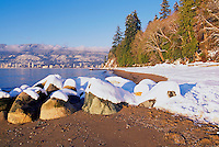 Stanley Park, Vancouver, BC, British Columbia, Canada, Winter - Snow Covered Rocks on Beach along Stanley Park Seawall at English Bay