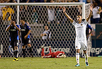 LA Galaxy defender Sean Franklin (28) begins to celebrate a goal. The LA Galaxy and the San Jose Earthquakes played to a 2-2 draw at Home Depot Center stadium in Carson, California on Thursday July 22, 2010.