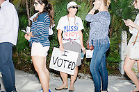 "Kathy Hudson, 54, of Estero, Florida, wears a sign reading ""Pussy Riot"" while waiting in line outside a campaign rally for Democratic presidential nominee Hillary Clinton in the Theodore R. Gibson Health Center at Miami Dade College-Kendall Campus in Miami, Florida, USA. Asked about the shirt, Hudson said, ""Donald can use this word freely, but we can make a riot of our own,"" referring to a recently released tape from 2005 that included Republican presidential nominee Donald Trump saying that he can ""grab [women] by the pussy."" Hudson said the idea for the shirt ""dawned on me at 3am after the tape [was released]."""