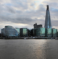 Shard London Bridge, also known as London Bridge Tower, 2012, Renzo Piano (right) and City Hall, Foster & Partners, 2002, Southbank, River Thames, London, UK. The 310m tall Shard is the tallest building in the European Union, incorporating offices, a hotel and residential apartments.  Nicknamed the London Egg, the 45m high City Hall is the headquarters of the Greater London Authority. Its glass and steel structure incorporates environmentally friendly features such as solar panels. Picture by Manuel Cohen