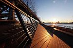 The sun rises over the Delaware River  from the Race Street Pier under the Benjamin Franklin Bridge in Philadelphia, Pennsylvania on January 18th 2012. (Photo By Brian Garfinkel)