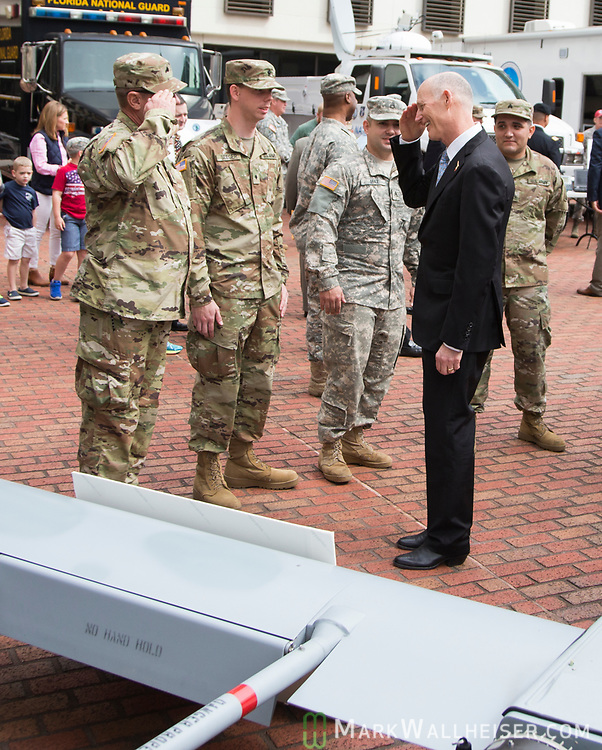 """Florida Governor Rick Scott salutes service members during the Florida Department of Military Affairs and the Florida National Guard sponsored """"Florida National Guard Day"""" at the Capitol"""