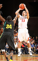 Dec. 17, 2010; Charlottesville, VA, USA; Virginia Cavaliers guard Sammy Zeglinski (13) shoots a three-point play over Oregon Ducks forward Joevan Catron (34) during the game at the John Paul Jones Arena. Virginia won 63-48. Mandatory Credit: Andrew Shurtleff-