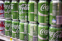 Six-packs of cans of the new Coca-Cola Life in a supermarket in New York on Tuesday, November 25, 2014.  The 60-calorie drink is sweetened with cane sugar and Stevia. The product appears to be popular with stores selling out with customers liking the taste and the green labeling. Previously the only way to get Coke made with cane sugar in the United States was to purchase imported Mexican bottled Coke or to buy the Kosher for Passover product (dietary laws prevent corn syrup being used).  (© Richard B. Levine)