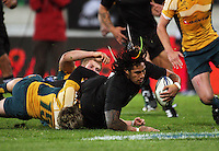 Ma'a  Nonu scores in the tackle of James O'Connor during the Investec Tri-Nations match between All Blacks and Australia at Westpac Stadium, Wellington, New Zealand on Saturday 19 September 2009. Photo: Dave Lintott / lintottphoto.co.nz