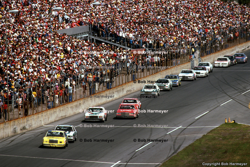 DAYTONA BEACH, FL - FEBRUARY 14: Dale Earnhardt, driving the #15 Bud Moore Ford, leads a group of cars during the Daytona 500 on February 14, 1982, at the Daytona International Speedway in Daytona Beach, Florida.