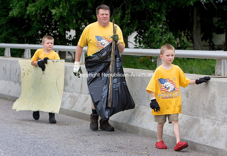 TORRINGTON CT. 06 June 2015-060615SV01-Don Whitford of Goshen with his sons Nevin, 8, right, and Logan, 6, emerge from the river with their trash they picked during a clean up of the Naugatuck River in Torrington Saturday. The group were with Cub Scout troop 35 from Goshen.<br /> Steven Valenti Republican-American