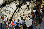 Haitian children wait in a queue in the food distribution center Saint Claire Parish in Port-au-Prince, Haiti, 8 July 2008. All property and food sources on Haiti are highly protected (sometimes by gunmen) due to frequent social storms and lootings. The overall situation on Haiti gets worse every year and the extreme, hardly imaginable poverty hits more and more people. The Haitian economics is paralysed, there is no infrastructure, no food supplies, the population suffer from hunger, social and living conditions in Haitian slums (e.g. Cité Soleil) are a human tragedy. The rage grows and the tension continues with undiminished strength.
