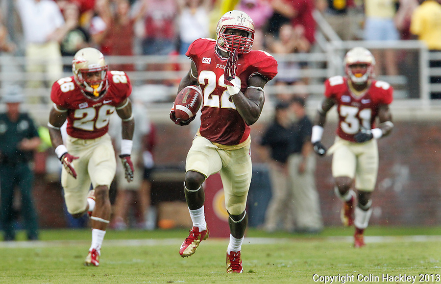 TALLAHASSEE, FLA 9/21/13-FSU-BCC092113CH-Florida State's Telvin Smith, center, heads for the endzone after intercepting a<br /> Bethune-Cookman pass during first half action Saturday at Doak Campbell Stadium in Tallahassee. <br /> COLIN HACKLEY PHOTO