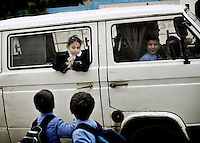 Gaza, Palestine 20090208 -  A girl watches two boys a she is taking by a minivan from school in Gaza city. Photo/copyright: Torbjorn Gronning