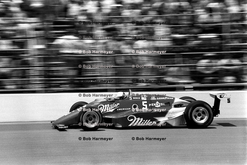 INDIANAPOLIS, IN - MAY 26: Danny Sullivan drives his March 85C 37/Cosworth en route to victory during the Indianapolis 500 USAC IndyCar race at the Indianapolis Motor Speedway in Indianapolis, Indiana, on May 26, 1985.