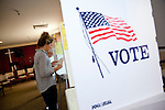 A voter casts her ballot at First Baptist Church Of Los Altos on Magdalena Avenue.