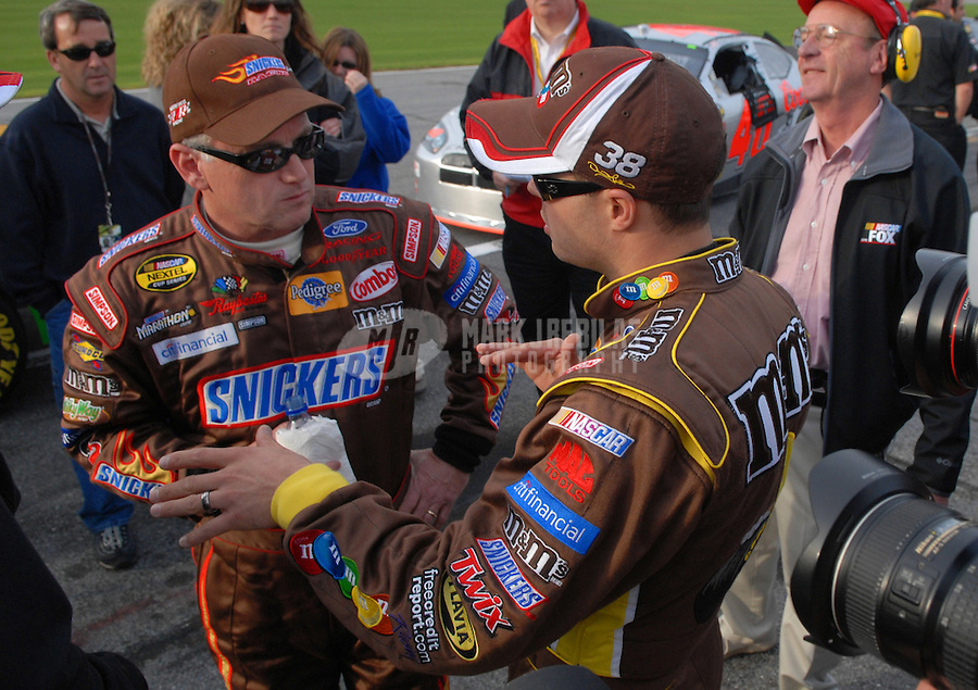 Feb 11, 2007; Daytona, FL, USA; Nascar Nextel Cup driver Ricky Rudd (88) talks with teammate David Gilliland (38) after Gilliland qualified on the pole for the Daytona 500 at Daytona International Speedway. Mandatory Credit: Mark J. Rebilas