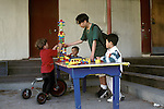 Albany CA Young teen boy doing volunteer work at preschool with kids, age three and four