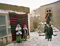 Relatives of the groom, at the bride's house in Khandut. Wedding celebration of Dodé Khuda..Wakhi wedding ceremonies usually takes place in the winter months. The Wakhi do most of their business with Afghan Kyrgyz..Winter expedition through the Wakhan Corridor and into the Afghan Pamir mountains, to document the life of the Afghan Kyrgyz tribe. January/February 2008. Afghanistan