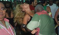 People dance samba and have fun at Mangueira Samba School rehearsal for the Rio de Janeiro carnival, Brazil. Multi-ethnic vibrant couple, ecstasy, carioca´s lifestyle.