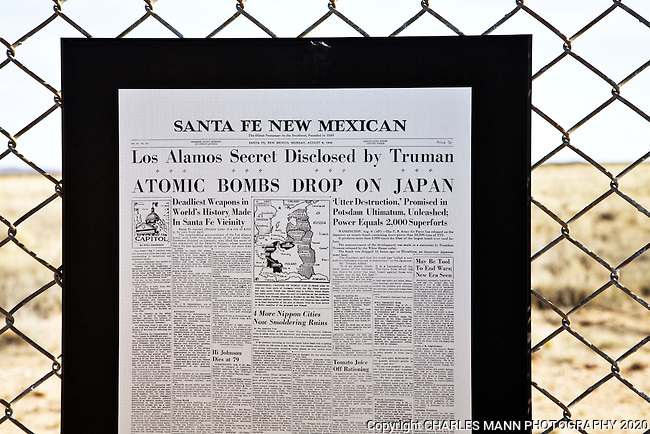 An information panel on display on a chain link fence at theTrinity Site near Socorro, NM, tells of a famous headline in the Santa Fe New Mexican newspaper in August 1944 that reveals news of the atomic bomb that was developed in Los Alamos.