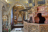 Sao Miguel Chapel, or St Michael's Chapel, designed in Manueline style 1517-22 by Marco Pires and completed by Diogo de Castilho, on the site of a 12th century chapel in the University of Coimbra, Coimbra, Portugal. In the chancel is the Mannerist altarpiece, designed by Bernardo Coelho in 1605 and made by sculptor Simon Mota, with paintings by Simon Rodrigues and Domingos Vieira Serrao. The chapel was renovated in the 17th and 18th centuries, with Manuel Ramos making the pulpit in 1684, ceiling painted by Francisco F de Araujo, tiled floor added 1613, Baroque organ with 2,000 pipes built 1733 by Fray Manuel de Sao Bento (right), and Gabriel Ferreira da Cunha painting chinoiserie elements in 1737. The University of Coimbra was first founded in 1290 and moved to Coimbra in 1308 and to the royal palace in 1537. The building is listed as a historic monument and a UNESCO World Heritage Site. Picture by Manuel Cohen