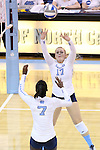 10 September 2015: North Carolina's Abigail Curry (17) sets the ball to Victoria McPherson (7). The University of North Carolina Tar Heels hosted the Stanford University Cardinal at Carmichael Arena in Chapel Hill, NC in a 2015 NCAA Division I Women's Volleyball contest. North Carolina won the match 25-17, 27-25, 25-22.
