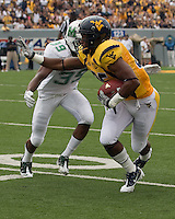WVU wide receiver Willie Milhouse. The WVU Mountaineers beat the Marshall Thundering Herd 34-13 in a game called just after the fourth quarter started because of severe thunderstorms in the area. The game was played at Milan Puskar Stadium in Morgantown, West Virginia on September 4, 2011.