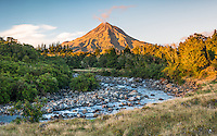 Sunrise over Waiwhakaiho River and Taranaki, Mt. Egmont, in background, Egmont National Park, North Island, New Zealand, NZ