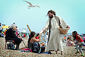 JESUS FEEDS THE 5,000 ON BRIGHTON BEACH.