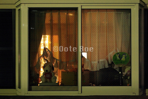 domestic house window seen from the outside during night time