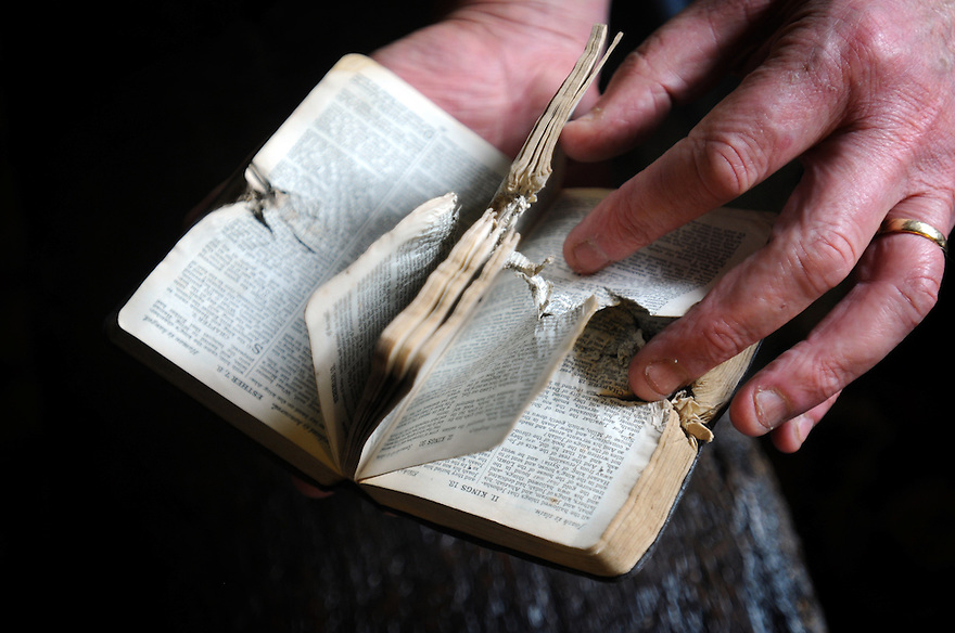 First World War Bible of Arthur Ingham whose life was saved when a piece of shrapnel became embedded in it. Now owned by Philip Douetil, Surrey. Photo by Clare Kendall.
