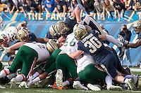 The Pitt defense lead by Matt Galambos (47) and Mike Caprara (30) unsuccessfully prevent a Miami quarterback sneak for a touchdown  by The Miami Hurricanes quarterback Brad Kaaya. football team defeated the Pitt Panthers 29-24 on  Friday, November 27, 2015 at Heinz Field, Pittsburgh, Pennsylvania.