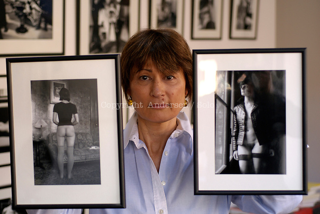 Catherine Millet at home with pictures by Jacques Henric.