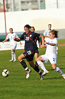 Abby Wambach dribbles away from an Icelandic defender. The USWNT defeated Iceland (2-0) at Vila Real Sto. Antonio in their opener of the 2010 Algarve Cup on February 24, 2010.