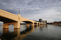 Tempe, Arizona. A southern view of Tempe Town Lake at sunset shows the Mill Avenue bridges. Photo by Eduardo Barraza © 2015